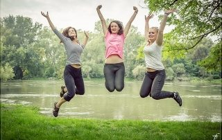 women jumping happy happiness hacks rraw energy