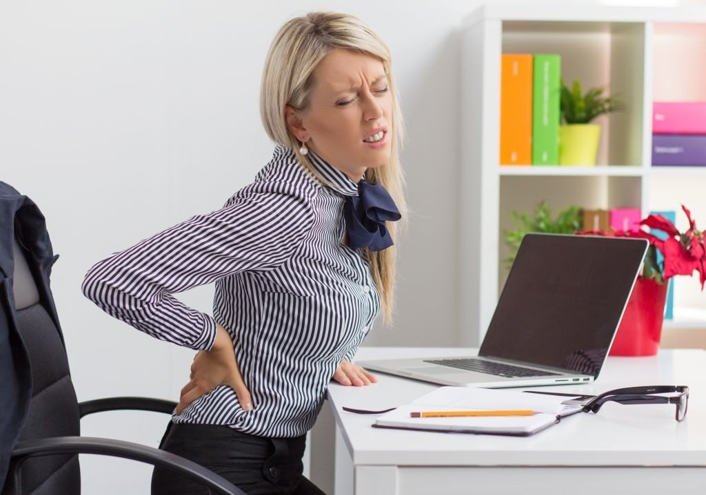 woman desk back pain