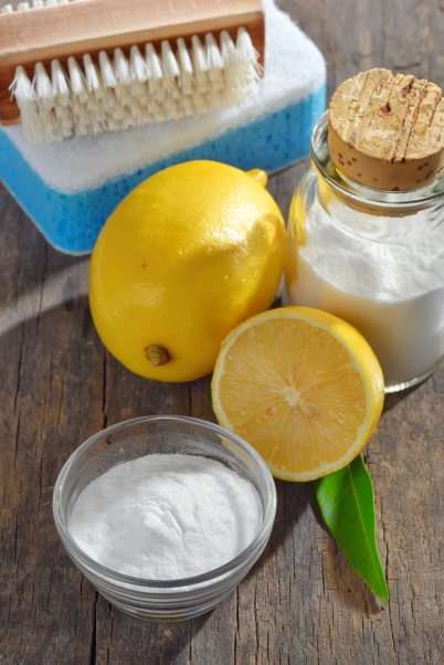 Homemade green cleaning.Lemon and baking soda on old wooden background raw energy