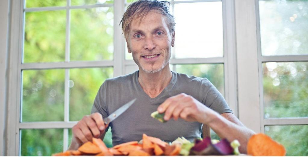 Lawrence Mitchell cutting up veg